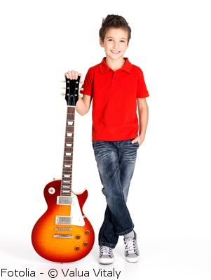 kid with an electric guitar