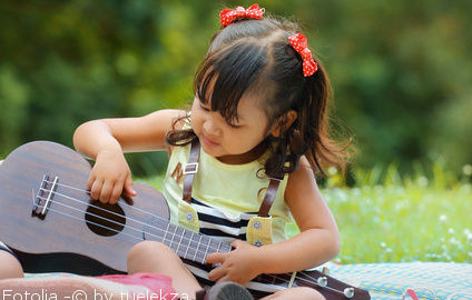 Little child with ukulele