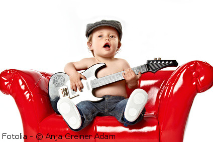 toddler with toy guitar